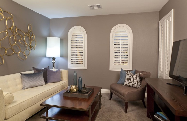 Fort Lauderdale family room with rounded plantation shutters.