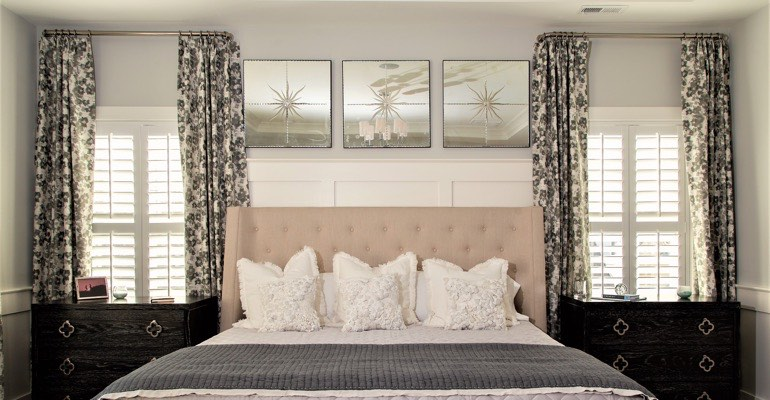 Beautiful bedroom with plantation shutters.