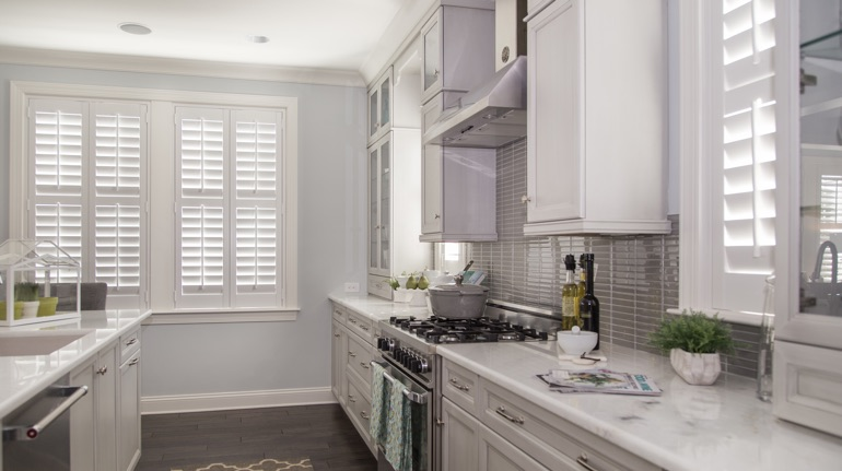 Plantation shutters in Fort Lauderdale kitchen with modern appliances.