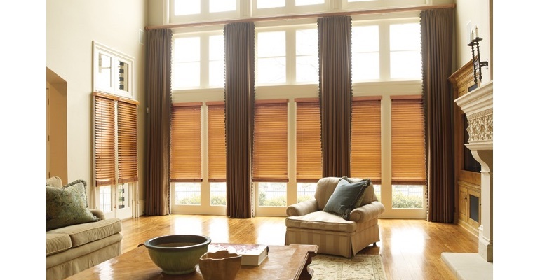 Fort Lauderdale great room with natural wood blinds and full-length drapes.