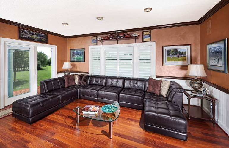 Fort Lauderdale basement with glass doors and plantation shutters.