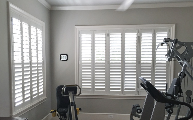 Fort Lauderdale fitness room with shuttered windows.