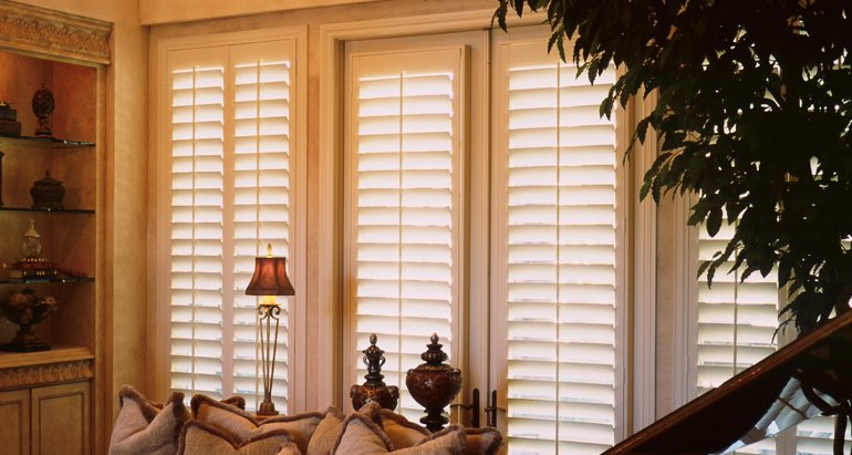 Plantation shutters on french door and window in Fort Lauderdale lounge