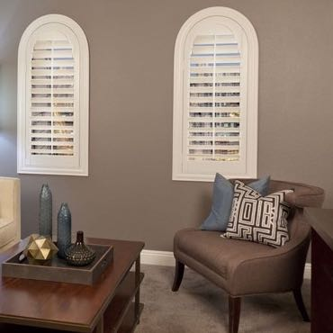 Fort Lauderdale family room arched shutters.