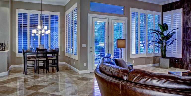 Fort Lauderdale great room with plantation shutters and modern lighting.