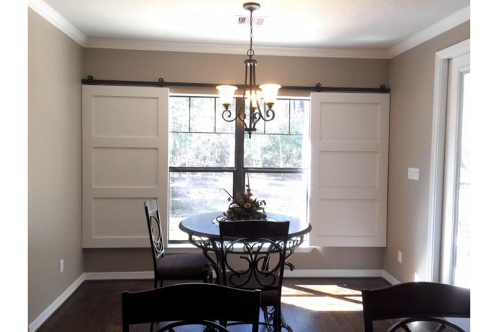 Fort Lauderdale dining room with moveable barn door shutters.