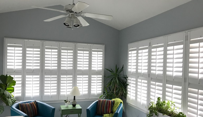 Fort Lauderdale sunroom with fan and shutters
