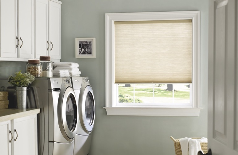 Fort Lauderdale laundry room with pull-down window shades.