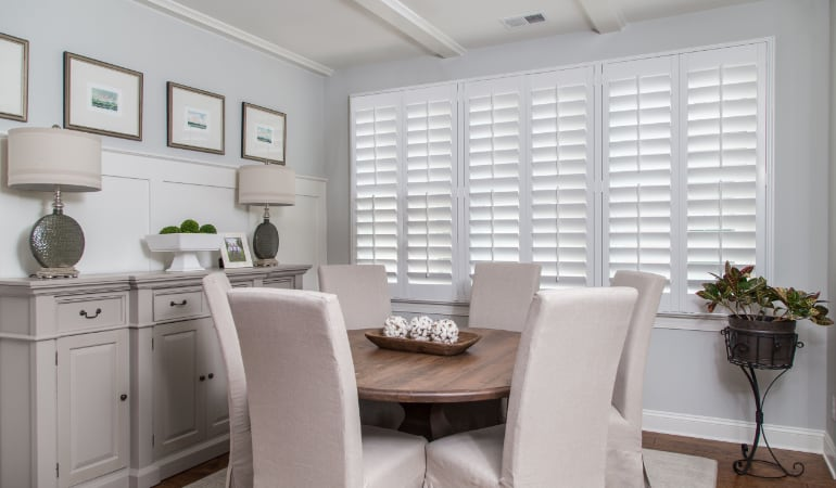 Plantation shutters in a Fort Lauderdale dining room.