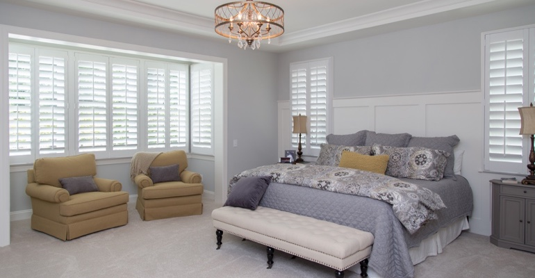White shutters in Fort Lauderdale bedroom.