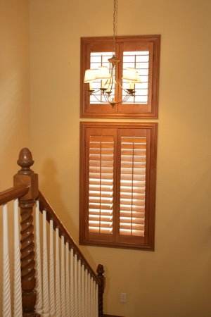 Ovation shutters in tan stairwell.