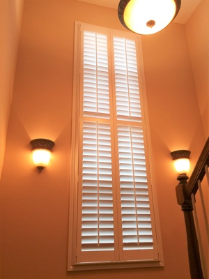 Polywood plantation shutters in well-lit stairwell.
