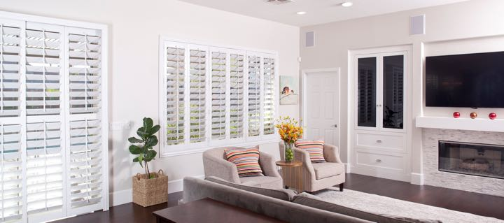 Fort Lauderdale living room in white with plantation shutters.
