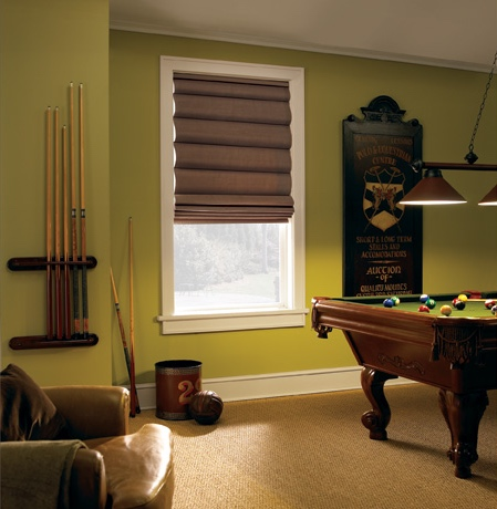 Roman shades in Fort Lauderdale pool room with green walls.