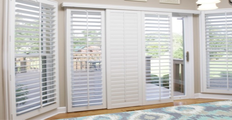 [Polywood|Plantation|Interior ]211] shutters on a sliding glass door in Fort Lauderdale
