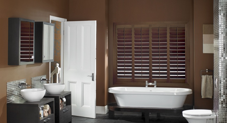 Stained wood shutter in Fort Lauderdale bathroom