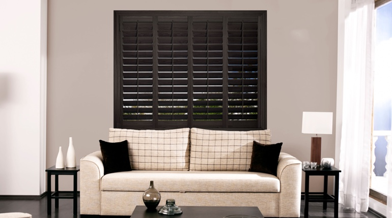 Fort Lauderdale living room with plantation shutters.