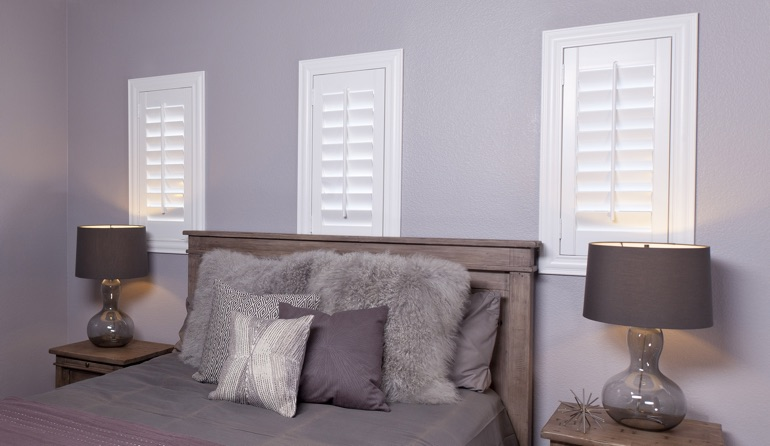 Classic plantation shutters in Fort Lauderdale bedroom windows.