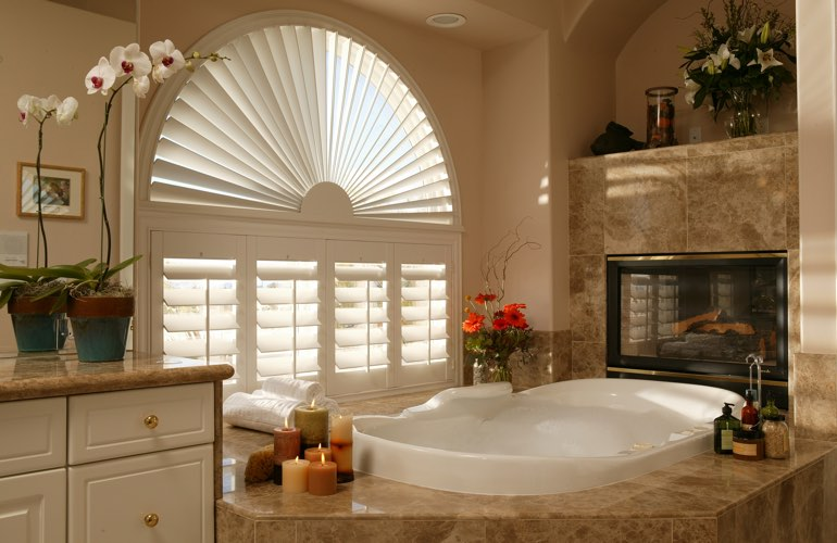 Semicircle shutters in a Fort Lauderdale bathroom.