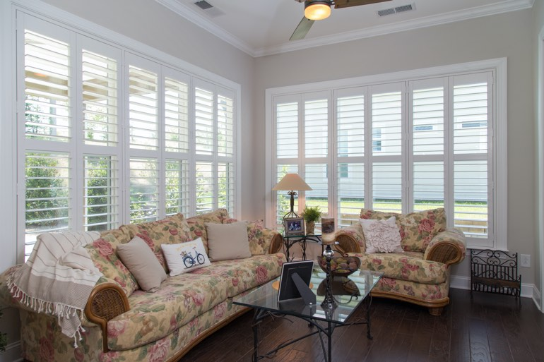 Traditional sunroom with plantation shutters in Fort Lauderdale.