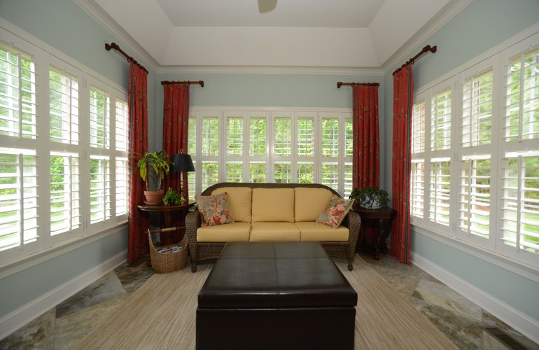 Fort Lauderdale sunroom with white window shutters.