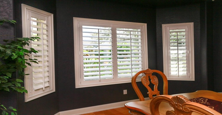 White Plantation Shutters In Dark Green Dining Room