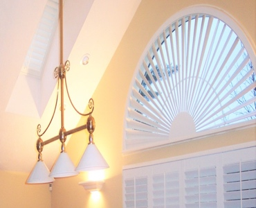Fort Lauderdale arched eyebrow window with white shutter