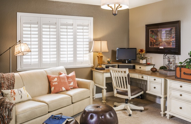Fort Lauderdale home office with plantation window shutters.