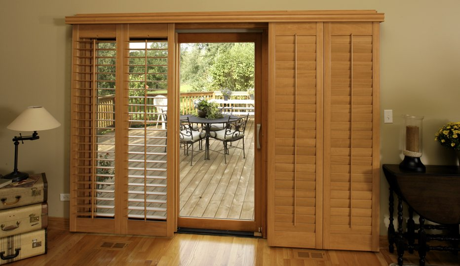 Wood bypass patio door shutters in Fort Lauderdale living room
