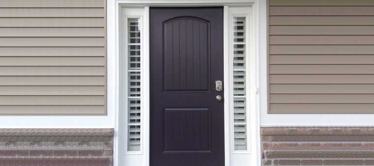 Entry Door Sidelight Shutters Next To Black Door In Fort Lauderdale, FL