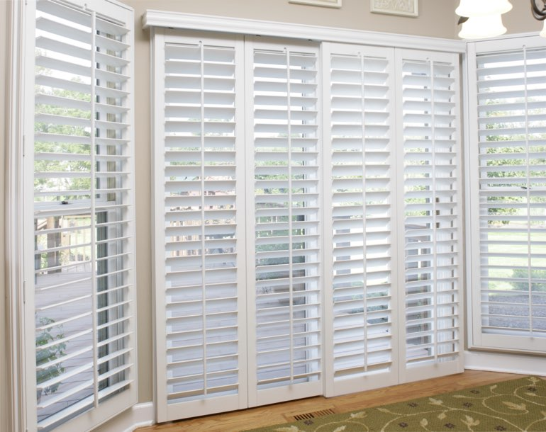 Sliding glass door with plantation shutters Fort Lauderdale