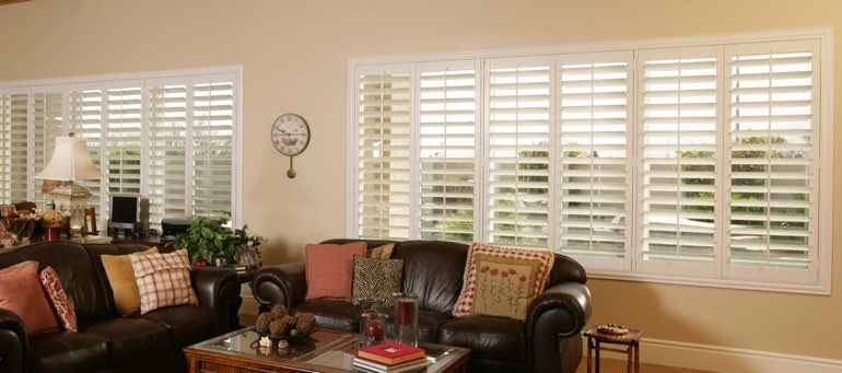 Wide window with interior shutters in Fort Lauderdale living room